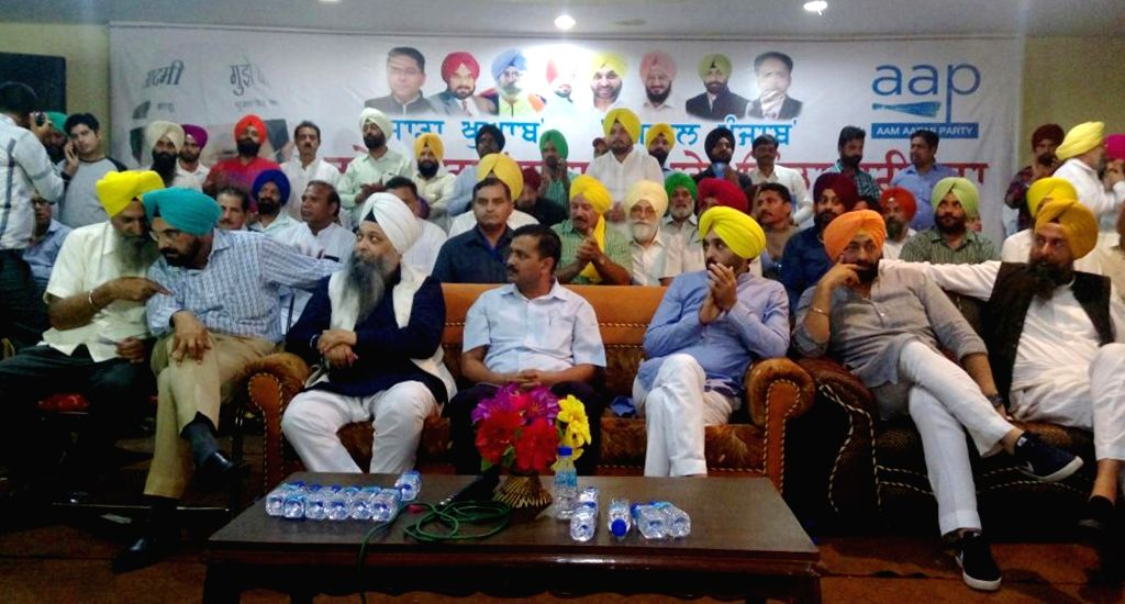 Delhi Chief Minister and AAP national convener Arvind Kejriwal during a programm in Batala on Oct 25, 2016. Also seen AAP MP Bhagwant Mann. - Arvind Kejriwal