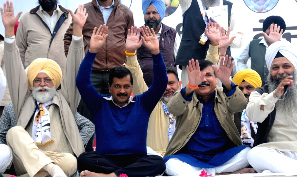 Delhi Chief Minister and AAP national convener Arvind Kejriwal during a rally in Amritsar on Nov 30, 2016. Also seen AAP leader Sanjay Singh. - Arvind Kejriwal and Sanjay Singh