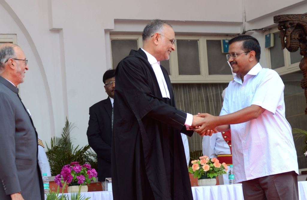 Delhi Chief Minister Arvind Kejriwal congratulates Justice Dhirubhai Naranbhai Patel after he took oath as the Chief Justice of Delhi High Court, in New Delhi on June 7, 2019. - Arvind Kejriwal and Dhirubhai Naranbhai Patel
