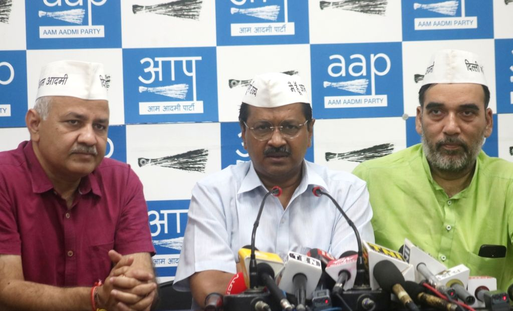 Delhi Chief Minister Arvind Kejriwal accompanied by Deputy Chief Minister Manish Sisodia and Cabinet Minister Gopal Rai, addresses a press conference in New Delhi, on May 8, 2019. - Arvind Kejriwal and Gopal Rai