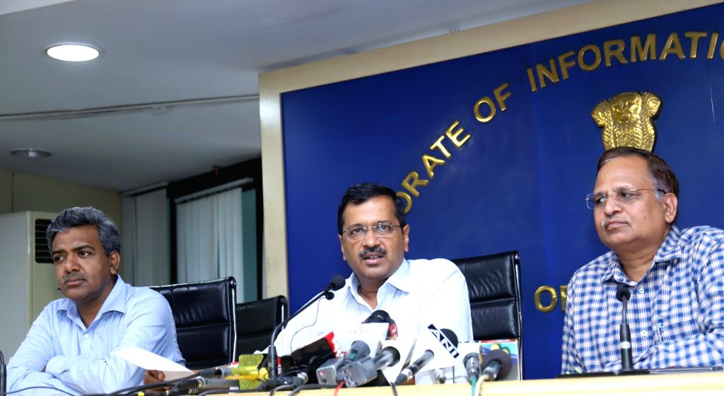 Delhi Chief Minister Arvind Kejriwal accompanied by Cabinet Minister Satyendra Kumar Jain, addresses a press conference in New Delhi on July 30, 2019. - Arvind Kejriwal and Satyendra Kumar Jain