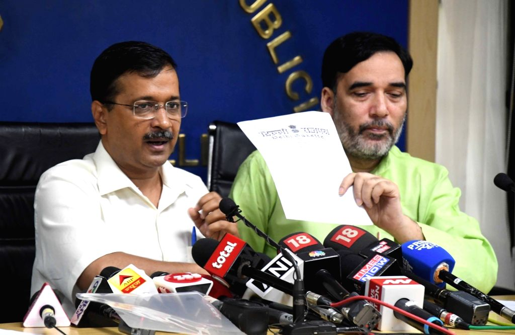 Delhi Chief Minister Arvind Kejriwal accompanied by Cabinet Minister Gopal Rai, addresses a press conference in New Delhi on Oct 28, 2019. - Arvind Kejriwal and Gopal Rai