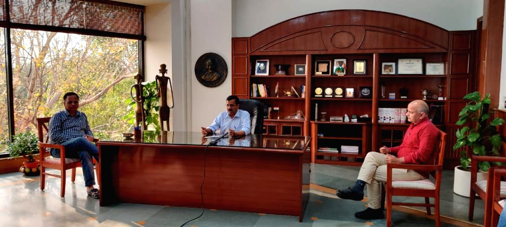 Delhi Chief Minister Arvind Kejriwal addresses first digital press briefing on COVID-19, on March 21, 2020. Also seen Delhi Health Minister Satyendra Jain and Deputy Chief Minister Manish Sisodia. - Arvind Kejriwal and Satyendra Jain