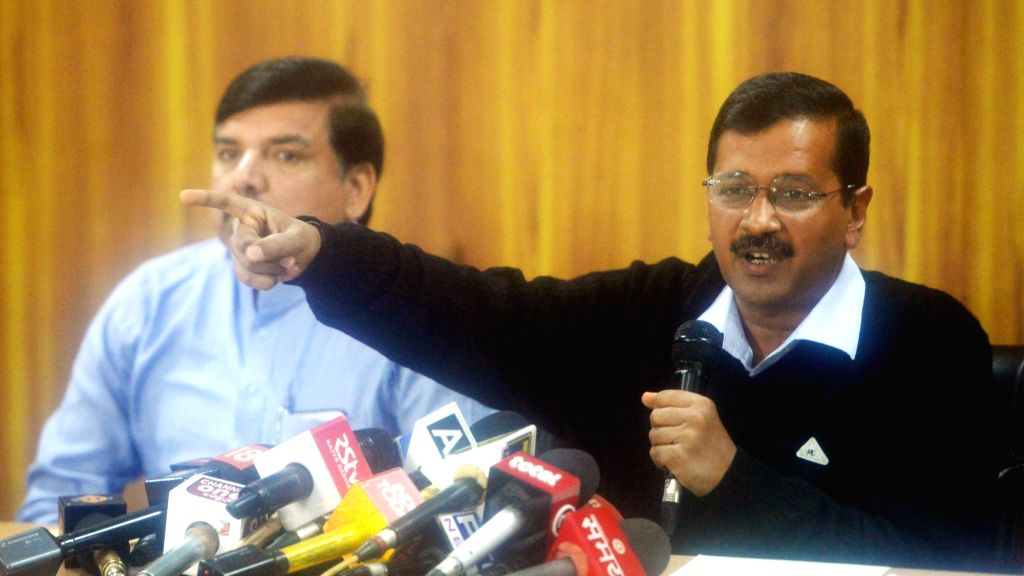 Delhi Chief Minister Arvind Kejriwal addresses a press conference in New Delhi on March 15, 2017. Also seen AAP leader Sanjay Singh. - Arvind Kejriwal and Sanjay Singh