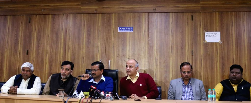 Delhi Chief Minister Arvind Kejriwal addresses a press conference in New Delhi on Feb 14, 2019. Also seen Deputy Chief Minister Manish Sisodia, Gopal Rai, Satyendar Jain. - Arvind Kejriwal, Gopal Rai and Satyendar Jain
