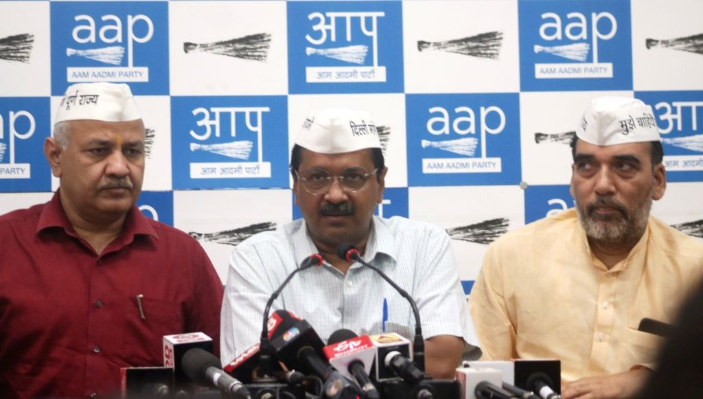 Delhi Chief Minister Arvind Kejriwal addresses a press conference in New Delhi on May 6, 2019. Also seen Deputy Chief Minister Manish Sisodia and minister Gopal Rai. - Arvind Kejriwal and Gopal Rai