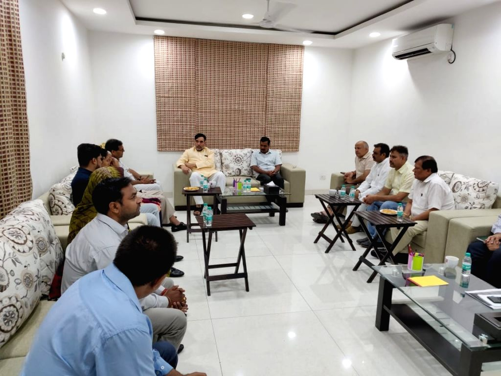 Delhi Chief Minister Arvind Kejriwal and Cabinet Minister Gopal Rai meet the family members of businessman Dhruv Tyagi, who was murdered at West Delhi's Basai Darapur village; in New Delhi ... - Arvind Kejriwal and Gopal Rai