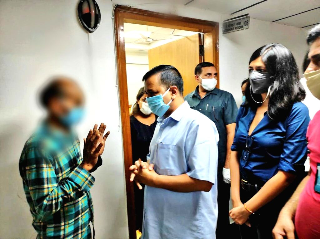 Delhi Chief Minister Arvind Kejriwal and Delhi Commission for Women (DCW) chief Swati Maliwal meet the family members of a 12-year-old sexual assault vitim at AIIMS in New Delhi on Aug 6, ... - Arvind Kejriwal