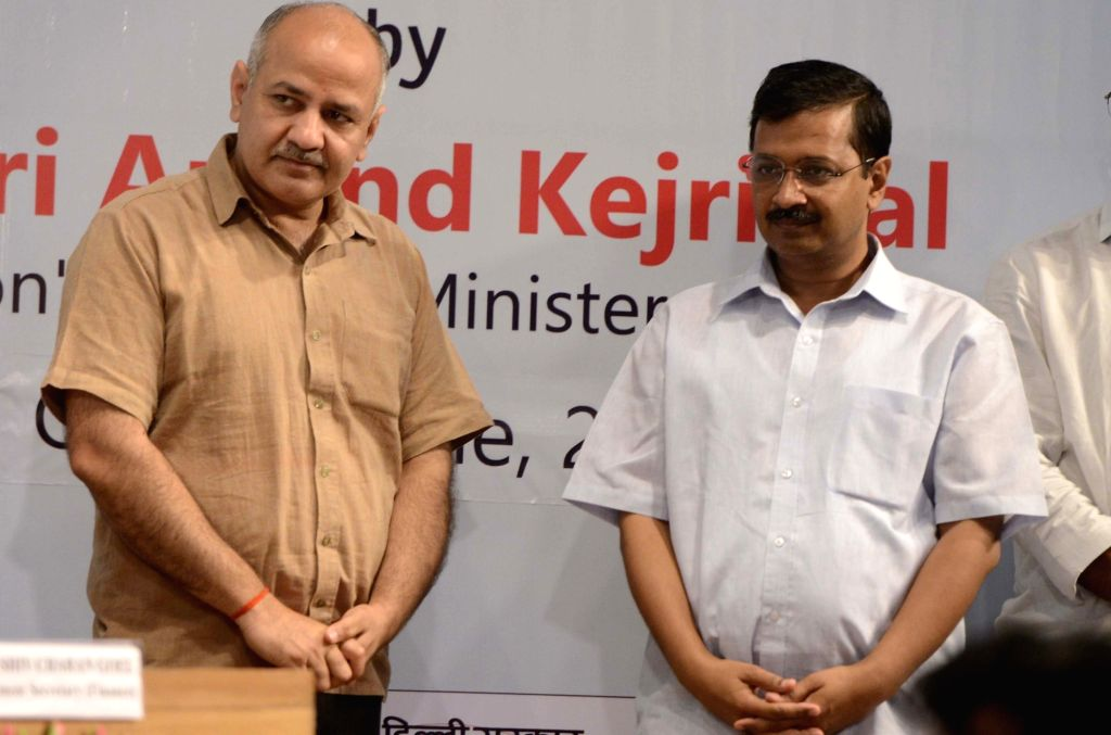 Delhi Chief Minister Arvind Kejriwal and Delhi Deputy Chief Minister Manish Sisodia during the annual award function of Department Of Trade & Taxes in New Delhi, on June 16, 2016. - Arvind Kejriwal