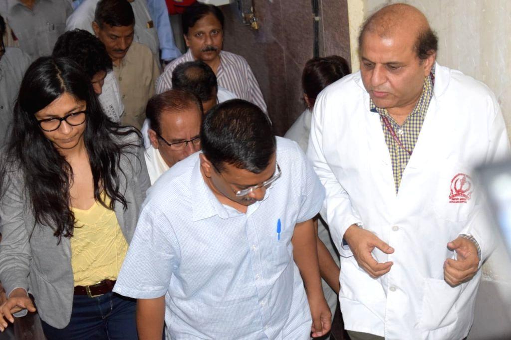 Delhi Chief Minister Arvind Kejriwal and Delhi Commission for Women (DCW) chief Swati Maliwal at Safdarjung Hospital to meet the minor raped in West Delhi's Janakpuri area; on July 17, ... - Arvind Kejriwal