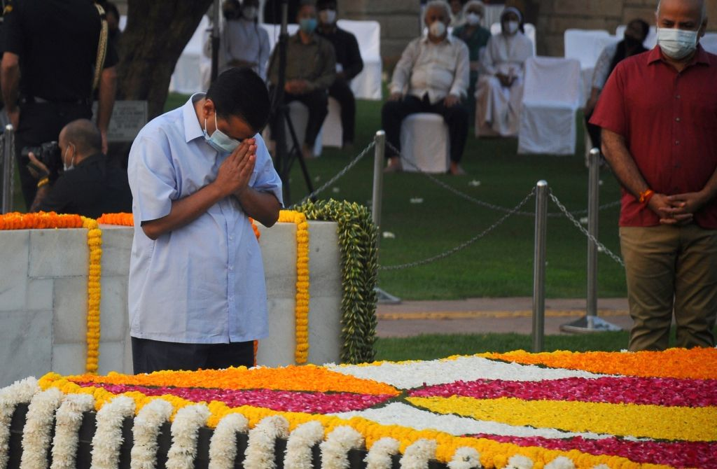 Delhi Chief Minister Arvind Kejriwal and Deputy CM Manish Sisodia paying floral tributes on the occassion of Birth Anniversary of Mahatma Gandhi at Rajghat, in New Delhi on Saturday ... - Arvind Kejriwal