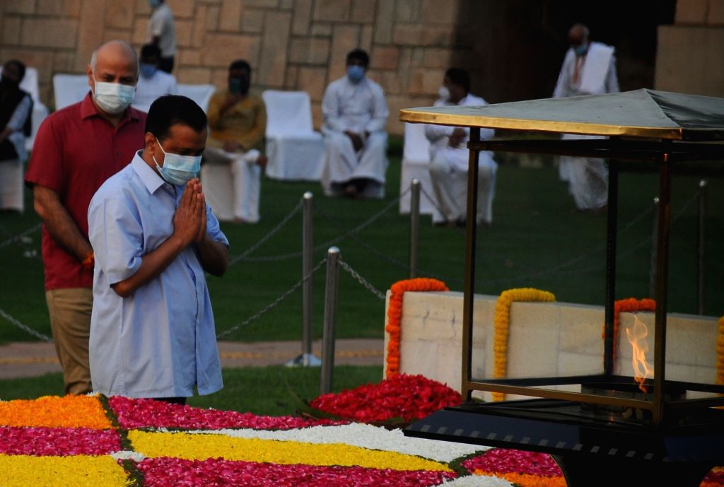 Delhi Chief Minister Arvind Kejriwal and Deputy CM Manish Sisodia paying floral tributes on the occasion of Birth Anniversary of Mahatma Gandhi at Rajghat, in New Delhi on Saturday October ... - Arvind Kejriwal