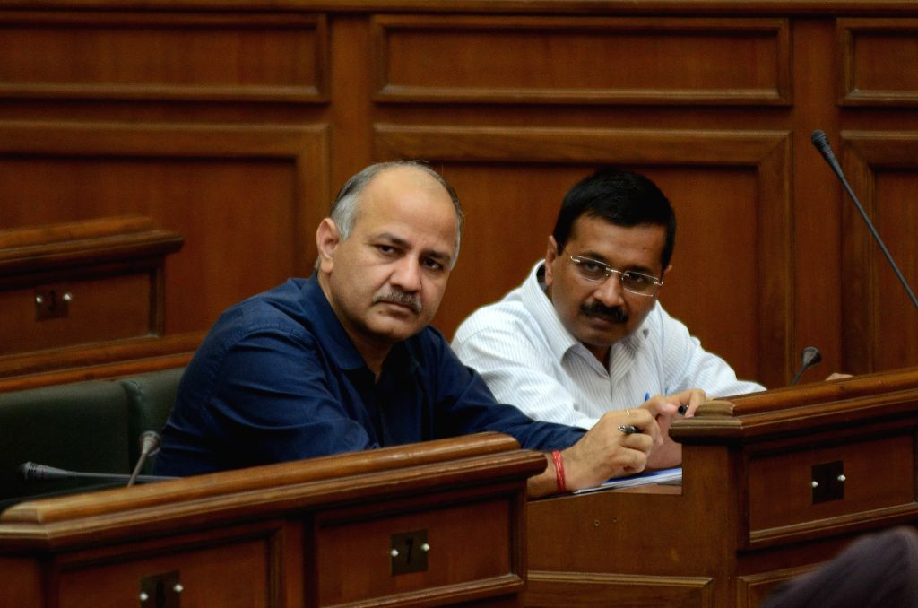Delhi Chief Minister Arvind Kejriwal and Deputy Chief Minister Manish Sisodia interact at the Delhi Legislative Assembly on the Day 1 of the monsoon session of the house in New Delhi on ... - Arvind Kejriwal