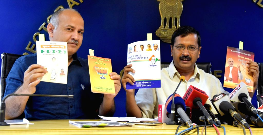 Delhi Chief Minister Arvind Kejriwal and Deputy Chief Minister Manish Sisodia addresses a press conference in New Delhi on May 17, 2016. - Arvind Kejriwal