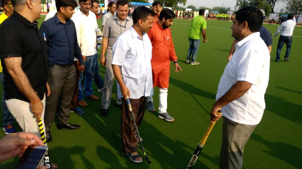 Delhi Chief Minister Arvind Kejriwal and Deputy Chief Minister Manish Sisodia during a hockey match in New Delhi on June 24, 2017. - Arvind Kejriwal