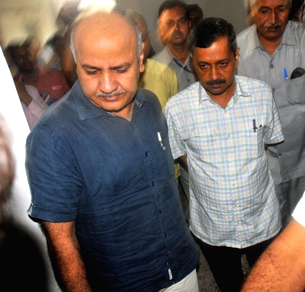 Delhi Chief Minister Arvind Kejriwal and Deputy Chief Minister Manish Sisodia arrive to attend two-day long session of State Assembly in New Delhi on June 28, 2017. - Arvind Kejriwal