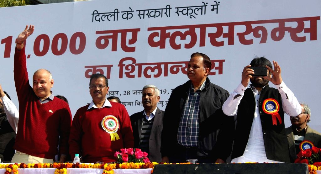 Delhi Chief Minister Arvind Kejriwal and Deputy Chief Minister Manish Sisodia at the foundation stone laying ceremony of 11,000 new classrooms in government schools of the national ... - Arvind Kejriwal