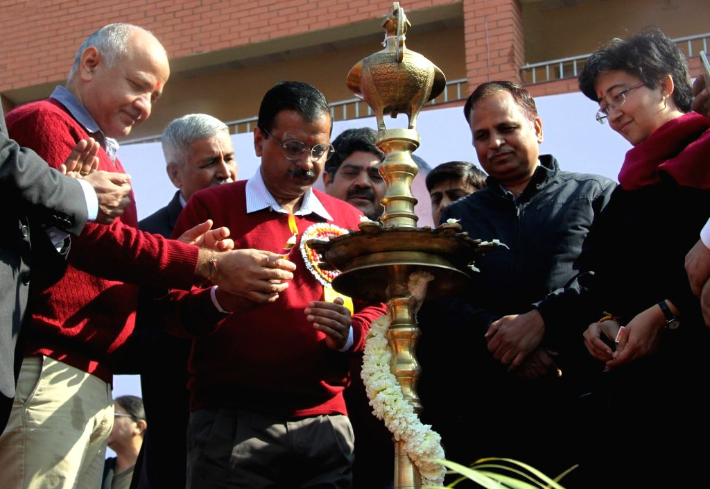 Delhi Chief Minister Arvind Kejriwal and Deputy Chief Minister Manish Sisodia light the inuagural lamp at the foundation stone laying ceremony of 11,000 new classrooms in government ... - Arvind Kejriwal