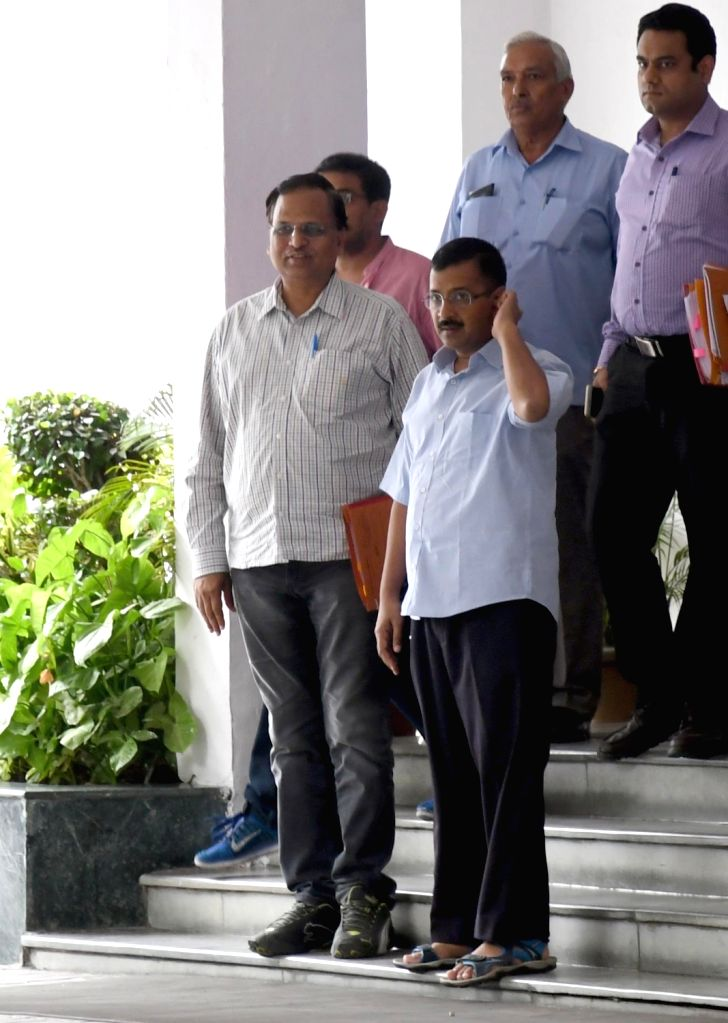 Delhi Chief Minister Arvind Kejriwal and Health Minister Satyendra Jain leave after meeting with Delhi Lt Governor Najeeb Jung at LG House in New Delhi on Oct 5, 2016. - Arvind Kejriwal and Satyendra Jain