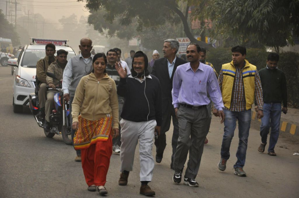 Delhi Chief Minister Arvind Kejriwal and his wife Sunita Kejriwal during their morning walk in Ghaziabad on Feb 18, 2015. Uttar Pradesh policemen are seen guarding the Chief Minister and his wife. - Arvind Kejriwal and Sunita Kejriwal
