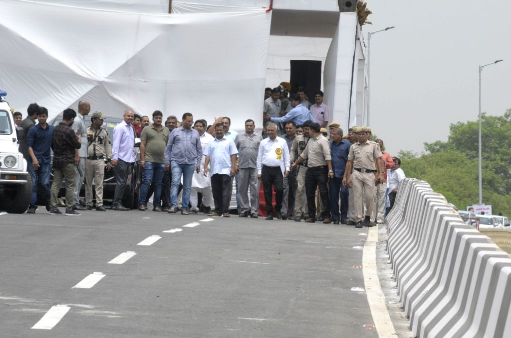 Delhi Chief Minister Arvind Kejriwal and Public Works Department Minister Satyendra Kumar Jain arrive to inaugurate the newly constructed Rao Tula Ram (RTR) Flyover at Outer Ring Road near ... - Arvind Kejriwal and Satyendra Kumar Jain
