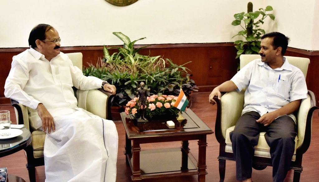 Delhi Chief Minister Arvind Kejriwal calls on Union Minister for Urban Development, Housing and Urban Poverty Alleviation and Information and Broadcasting M Venkaiah Naidu, in New Delhi on ... - Arvind Kejriwal and M Venkaiah Naidu