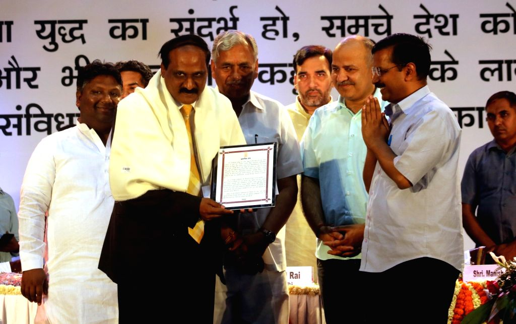 Delhi Chief Minister Arvind Kejriwal confers Ambedkar Ratan on UIDAI Deputy Director General Dr. Raja Sekhar Vundru during a programme organised to celebrate 125th birth anniversary of Dr ... - Arvind Kejriwal