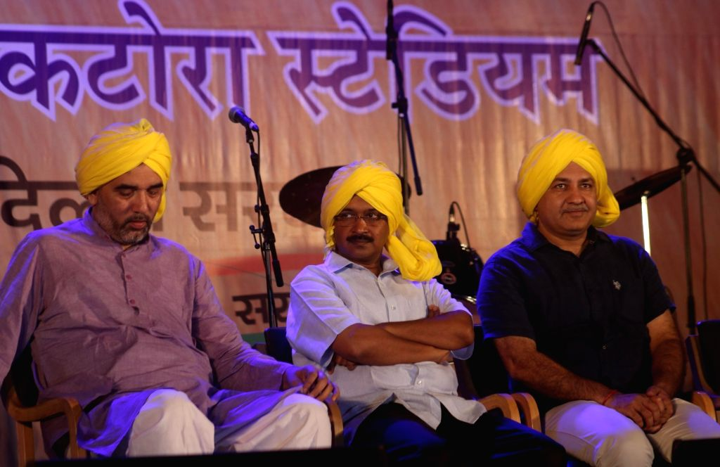 Delhi Chief Minister Arvind Kejriwal, Deputy Chief Minister Manish Sisodia with Delhi Transport Minister Gopal Rai during a programme organised on the eve of martyr Bhagat Singh's birth ... - Arvind Kejriwal, Gopal Rai and Bhagat Singh