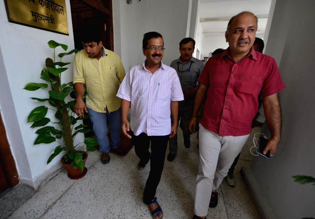 Delhi Chief Minister Arvind Kejriwal, Deputy Chief Minister Manish Sisodia, and Home Minister Satyendra Jain arrive at Delhi Assembly to attend a special session in New Delhi, on Sept 30, ... - Arvind Kejriwal and Satyendra Jain