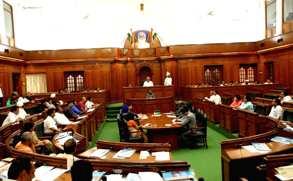 Delhi Chief Minister Arvind Kejriwal, Deputy Chief Minister Manish Sisodia and Home Minister Satyendra Jain during a special session at Delhi Assembly in New Delhi on Sept 30, 2016. - Arvind Kejriwal and Satyendra Jain