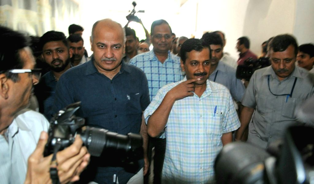Delhi Chief Minister Arvind Kejriwal, Deputy Chief Minister Manish Sisodia and Minister Satyendra Jain arrive to attend the special session of state assembly to discuss and approve the ... - Arvind Kejriwal and Satyendra Jain
