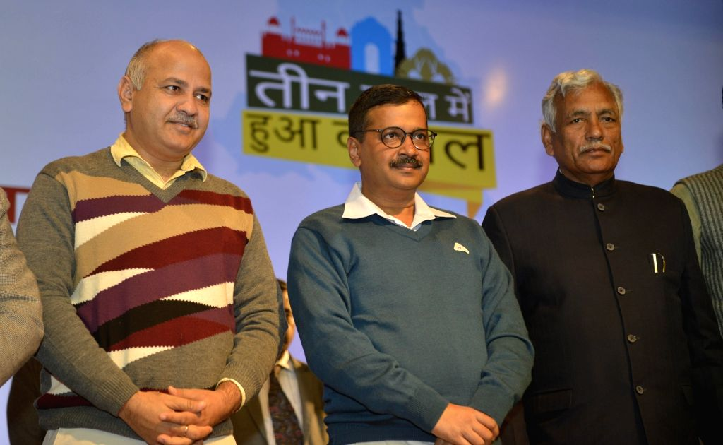 Delhi Chief Minister Arvind Kejriwal, Deputy Chief Minister Manish Sisodia with Delhi Speaker Ram Niwas Goel during a programme organised on completion of three years of Delhi Government, ... - Arvind Kejriwal