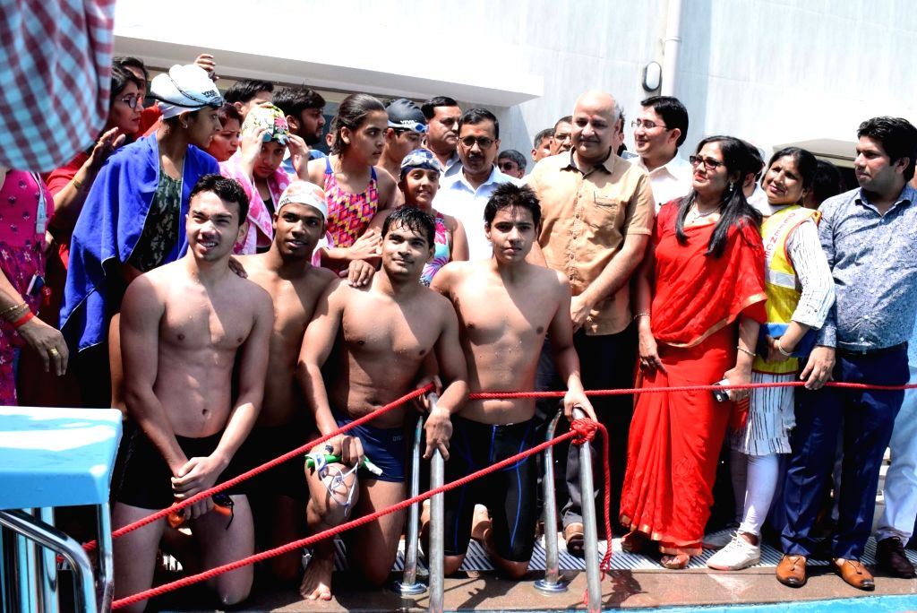 Delhi Chief Minister Arvind Kejriwal, Deputy Chief Minister and Education Minister Manish Sisodia and other dignitaries during a programme organised to inaugurate swimming pools in two ... - Arvind Kejriwal