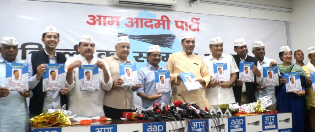 Delhi Chief Minister Arvind Kejriwal, Deputy Chief Minister Manish Sisodia, Cabinet Minister Gopal Rai, party leader Sanjay Singh and the party's Lok Sabha candidates from Delhi - Gugan ... - Arvind Kejriwal, Gopal Rai, Sanjay Singh, Gugan Singh Ranga, Balbir Singh Jakhar and Pankaj Gupta
