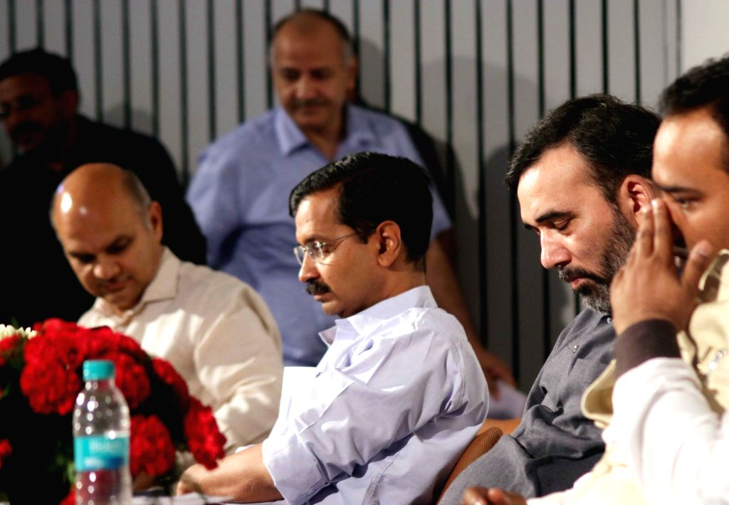 Delhi Chief Minister Arvind Kejriwal  during a programme organised to launch e-ration card in New Delhi, on March 27, 2015. Also seen Deputy Chief Minister Manish Sisodia and Transport Minister Gopal ... - Arvind Kejriwal and Gopal Rai