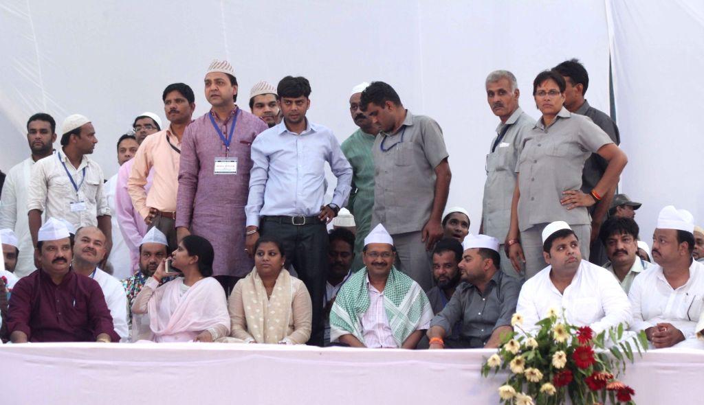 Delhi Chief Minister Arvind Kejriwal during an Iftaar party in New Delhi on June 24, 2016. Also seen AAP leader Rakhi Birla. - Arvind Kejriwal