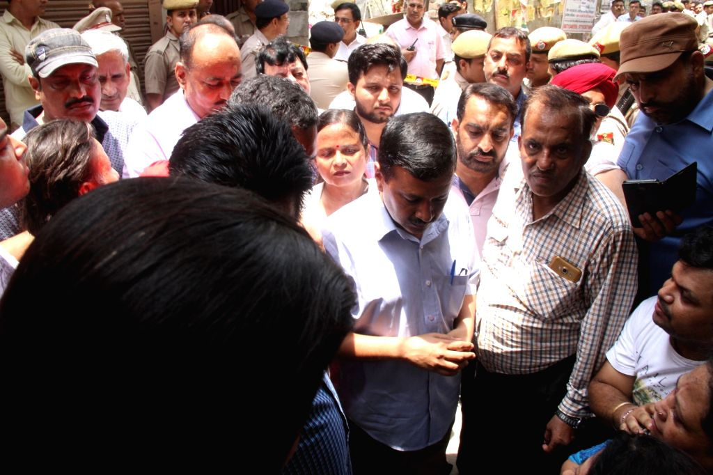 Delhi Chief Minister Arvind Kejriwal during his visit to the site where 11 members of a family were found deadsome blindfolded and hanging from an iron grill ceilingat their home, ... - Arvind Kejriwal
