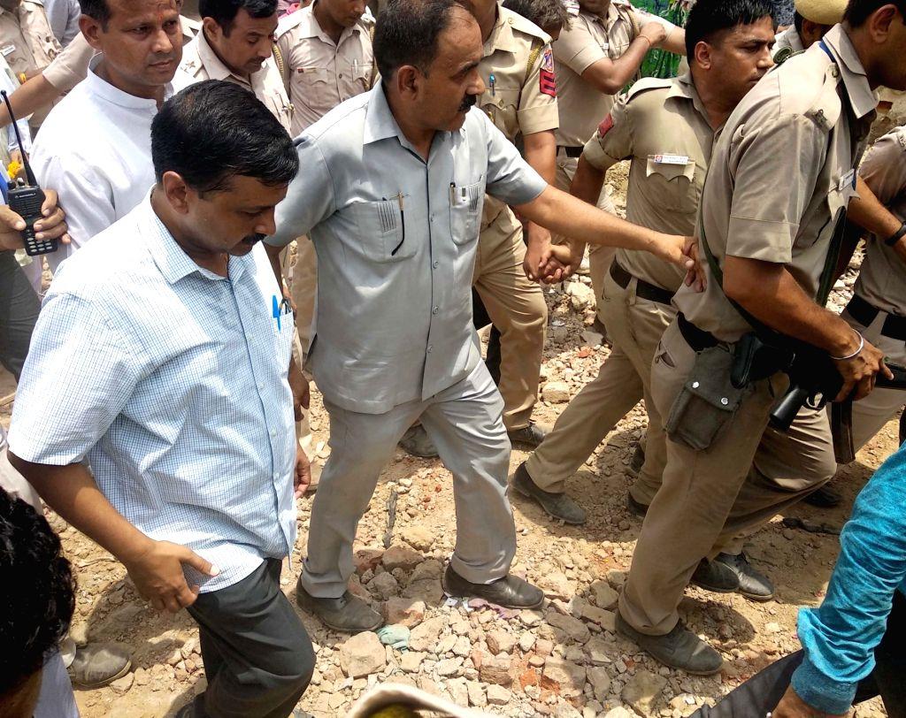 Delhi Chief Minister Arvind Kejriwal inspects development work at Kirari in New Delhi on July 7, 2018. - Arvind Kejriwal