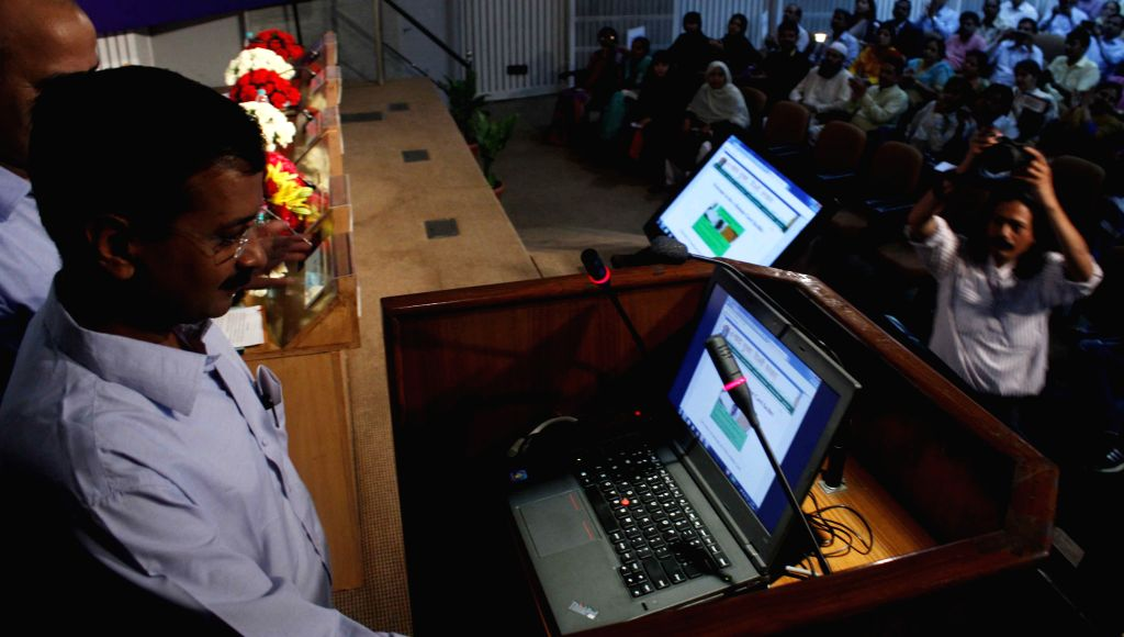 Delhi Chief Minister Arvind Kejriwal launches e-ration card during a programme in New Delhi, on March 27, 2015. - Arvind Kejriwal