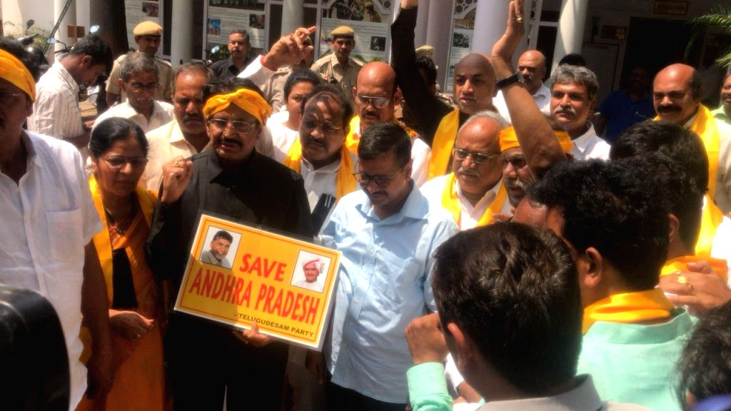 Delhi Chief Minister Arvind Kejriwal meets Telugu Desam Party (TDP) MPs who were detained by police while marching towards Prime Minister Narendra Modi's residence to demand special status ... - Arvind Kejriwal and Narendra Modi