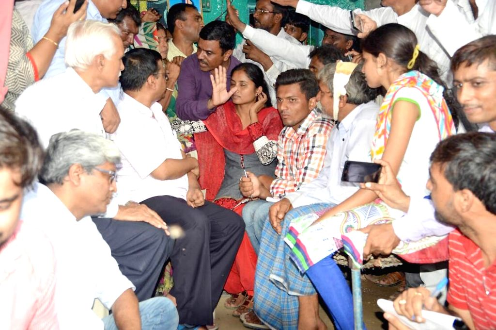 Delhi chief minister Arvind Kejriwal meets the parents of Una's village victims at Samdhiyala village in Gujarat on July 22, 2016. - Arvind Kejriwal