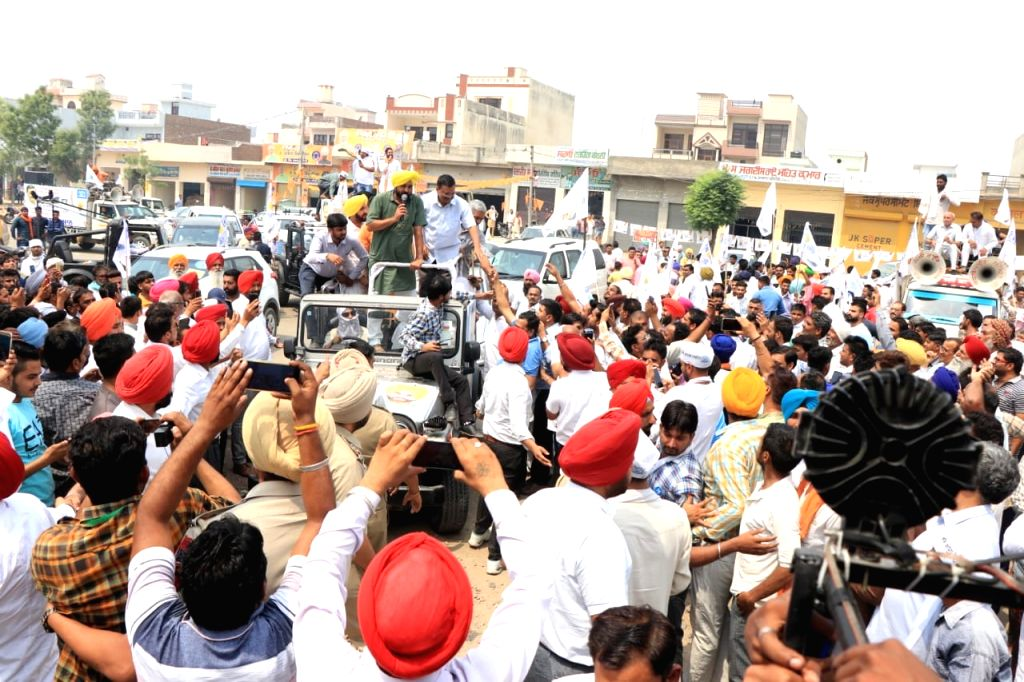 Delhi Chief Minister Arvind Kejriwal participates in a roadshow as he campaigns for AAP's Lok Sabha candidate from Sangrur, Bhagwant Mann ahead of the last phase of 2019 Lok Sabha elections, ... - Arvind Kejriwal