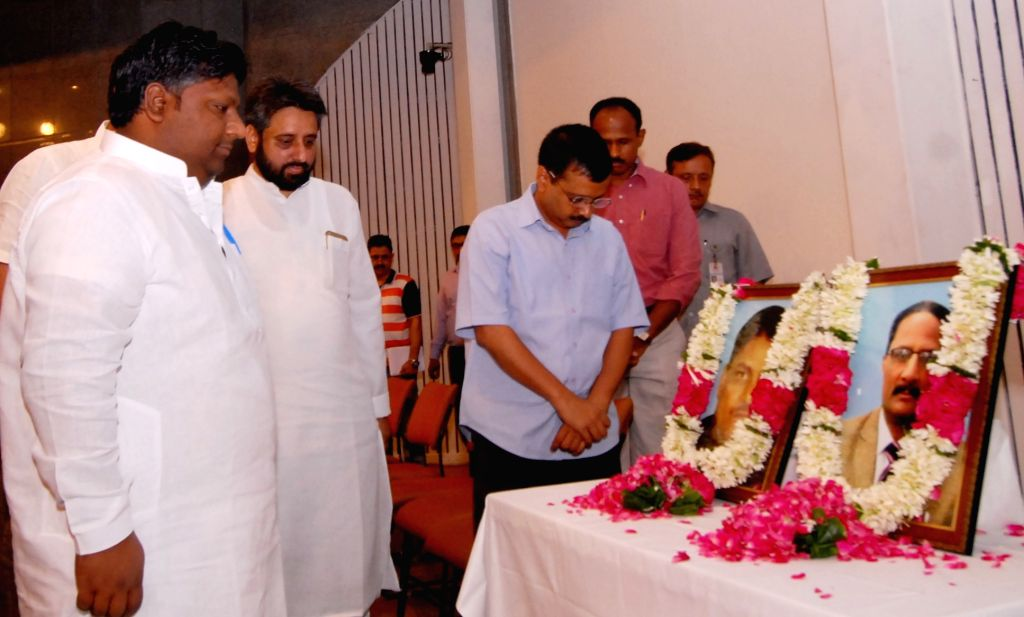 Delhi Chief Minister Arvind Kejriwal pays tribute to slain NIA officer Tanzeel Ahmed and NDMC official MM Khan during a programme Delhi Secretariat in New Delhi on July 2, 2016. - Arvind Kejriwal