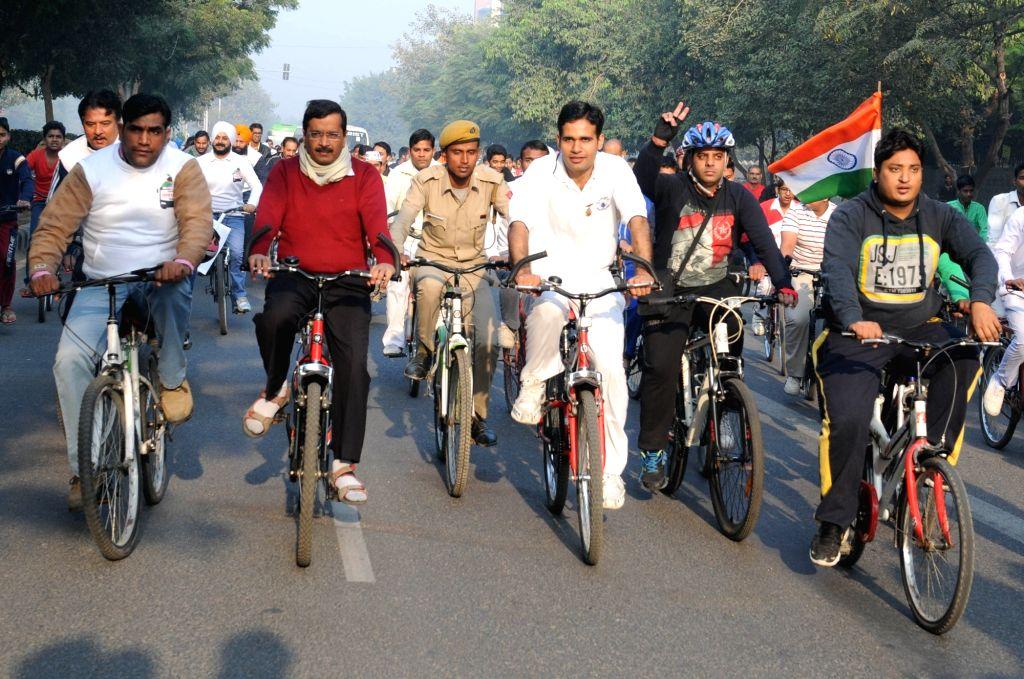 "Delhi Chief Minister Arvind Kejriwal rides a cycle during ""Car Free Day"" in New Delhi, on Nov 22, 2015. - Arvind Kejriwal"