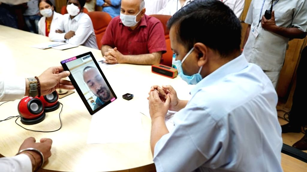 Delhi Chief Minister Arvind Kejriwal talking to a COVID-19 patient via video conferencing on Thursday. Now patients will be able to talk through video conferencing from hospitals. - Arvind Kejriwal