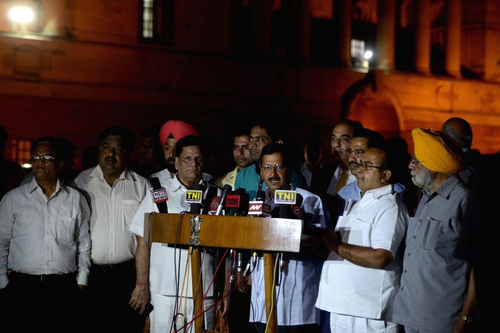 Delhi Chief Minister Arvind Kejriwal talks to press after meeting  President Pranab Mukherjee along with a delegation of jewellers at Rashtrapati Bhavan in New Delhi, on March 29, 2016. - Arvind Kejriwal and Pranab Mukherjee