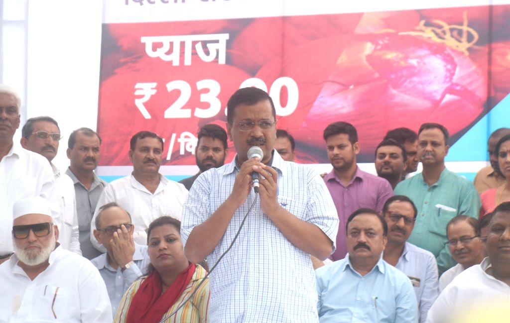 Delhi Chief Minister Arvind Kejriwal talks to media persons after flagging off mobile vans to provide onions at Rs 23.90 per kg in all 70 Vidhan sabhas, in New Delhi on Sep 28, 2019. The ... - Arvind Kejriwal
