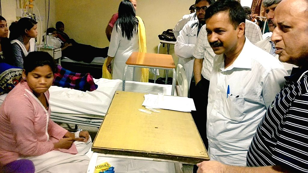 Delhi Chief Minister Arvind Kejriwal talks to the students who fell ill due to gas leak near the school in New Delhi on May 6, 2017. - Arvind Kejriwal