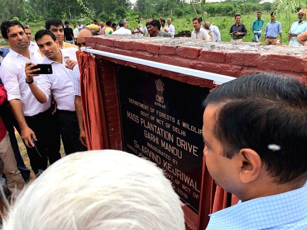 Delhi Chief Minister Arvind Kejriwal unveils the plaque to launch a mass plantation drive at Garhi Mandu, in New Delhi on Sept 7, 2018. Kejriwal launched the drive to increase the green ... - Arvind Kejriwal