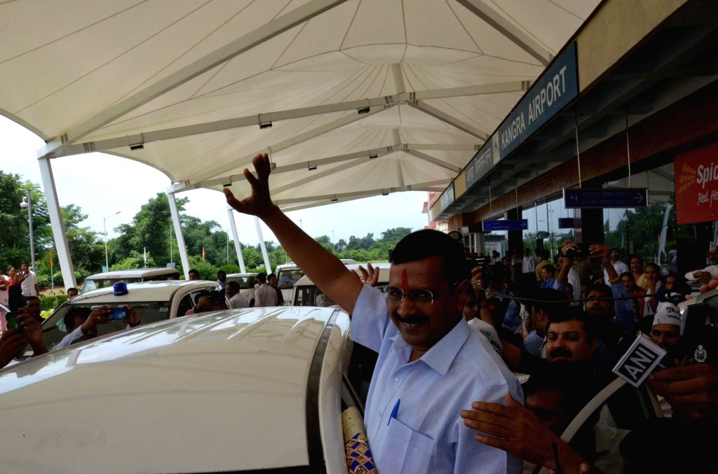 Delhi Chief Minister Arvind Kejriwal welcomed by AAP workers and supporters as he arrived at Kangra Airport in Dharamshala on Aug 1, 2016. Kejriwal arrives to attend a 10 day mediation ... - Arvind Kejriwal